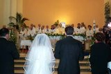 Vicka Ivankovic and Mario Mijatovic before the Altar in St. James Church