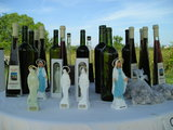 Selling wine, rakijas and statues of Our Lady