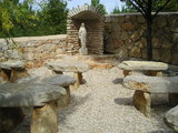 "Outer sitting before a Statue of Our Lady of Medjugorje at the ""Campo della Vita"""