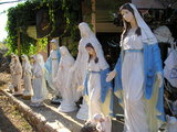 Statues of Mary at a shop down on the path to Krizevac