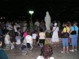 Praying and singing before Statue of Our Lady statue at Gospa Square